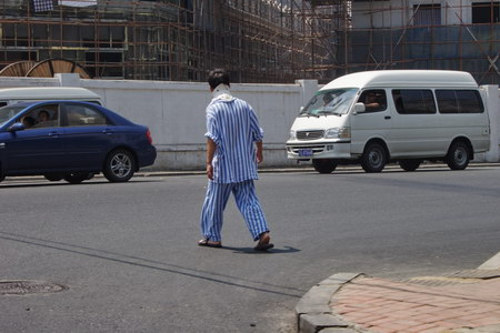Man in Pyjamas Crossing the Road
